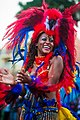 Guadeloupe winter carnival, Pointe-à-Pitre parade. A young woman, performer wearing traditional carnival outfit (waist up outdoor portrait)-2.jpg