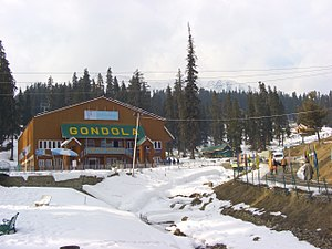 Kashmir Valley - Skiing is popular in Gulmarg, showing cable car in a snow clad mountain