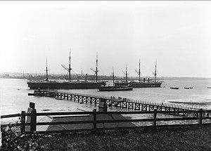 HMS Ganges (shore establishment) - HMS Minotaur, left; HMS Caroline, centre foreground; unidentified, right, circa. 1906
