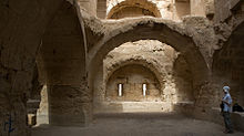 A room with well-built masonry walls and arches