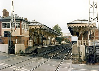 Hale railway station - Hale railway station in 1988 looking north from the level crossing with the signal box near left.