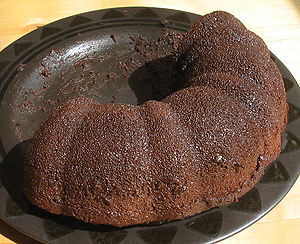 Half of a chocolate Bundt cake.