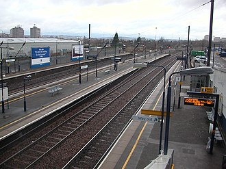 Hendon railway station - Northbound view across the four platforms. The two additional freight lines are behind the platform fencing on the extreme left. Off the right-hand side of the photograph, beyond the car park, runs the parallel M1 motorway.