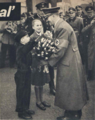 Hitler given flowers by Hitler Youth.png