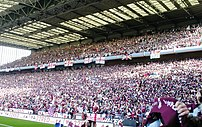A photo of the Holte End with a full attendanc...