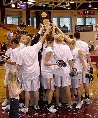 2006 in basketball - Hope College women's team raises 2006 NCAA Division III championship trophy.