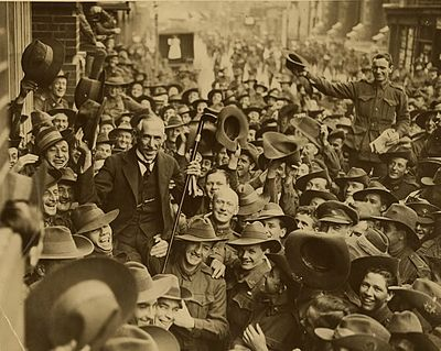 Australian soldiers carrying Prime Minister Billy Hughes, the 'little digger', down George Street, Sydney after his return from the Paris Peace Conference, 1919. Hughes Welcomehome Parispeaceconference.jpg