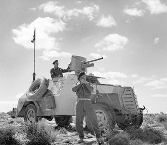 South African Army - A South African Marmon-Herrington Armoured Car conducting reconnaissance in North Africa.