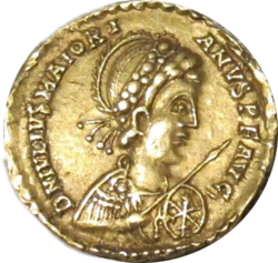 Golden coin depicting man facing right, wearing military garb and wielding a spear and shield