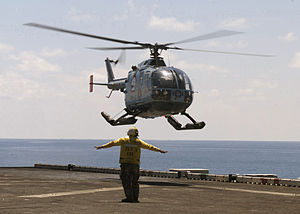 Indonesian Navy Bo 105 lands on USS Inchon (MCS-12) 2001.jpeg