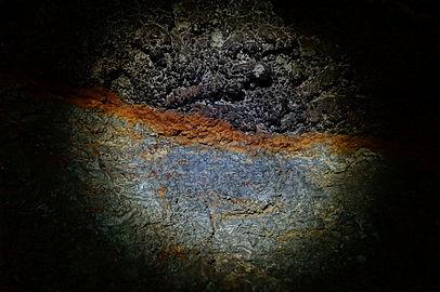 Iron-manganese layers on the wall of cave Zolushka.JPG