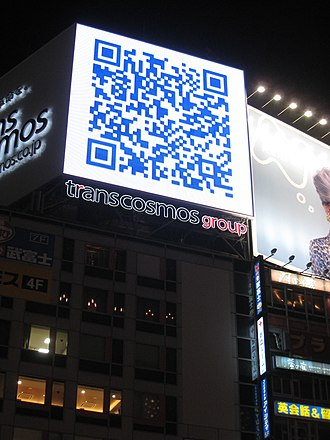 QR code - A QR code used on a large billboard in Japan, linking to the sagasou.mobi website