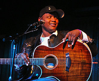Javier Colon - Colon with his guitar during a December 2014 performance