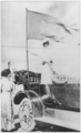 Jeannete Rankin holding a suffrage banner as chair of Montana Activities in 1913.png