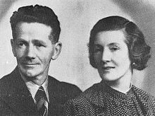 A photograph of a middle-aged man and woman