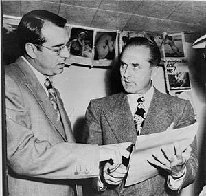 John Roselli - John Roselli (right) checks over a writ of habeas corpus with his lawyer, Frank DeSimone after Rosselli surrendered to U.S. Marshals in 1948.