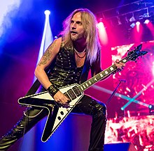 Richie Faulkner performing with Judas Priest in May 2015