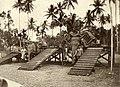 KNIL-soldaat en dwangarbeiders bij zwaar bepakte olifanten (2948428817).jpg
