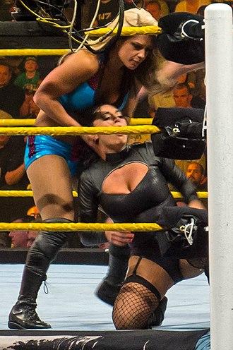 Catrina (wrestler) - Maxine (kneeling) wrestling Kaitlyn in April 2012