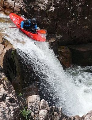 Glen Etive - A Kayaker running one of the larger waterfalls on the River Etive, commonly known as 'Right-angle'