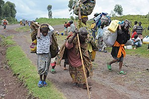 Internally displaced person - Villagers fleeing gunfire in a camp for internally displaced persons during the 2008 Nord-Kivu war