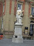 Kidderminster Town Hall - Sir Rowland Hill statue with guitar (29469776786).jpg