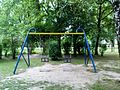 Kraków Kozłówek - the swings on the playground for children.JPG