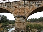 Fine stone bridge of dressed stone, three arches, metal balustrades. The road to Vryheid crosses the Pivaan River about 19 kilometres from Paulpietersburg. The bridge is another of the stone arched bridges built in the time of the Zuid Afrikaansche Republiek. On 9 December 1895, the Executive Committee resolved to build Type of site: Bridge Current use: bridge. Vryheid - Paulpietersburg route via Natal Hot Springs (not R33). From Vryheid left at turn-off. This fine stone bridge was completed in 1898 on the instructions of the Government of the South African Republic.