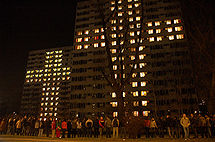 Crosses built up by lighted windows at students' residence in Krakow, Poland