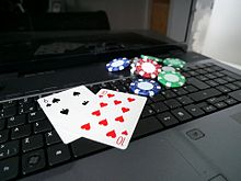 Laptop with poker cards and poker chips.jpg