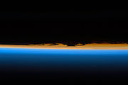 Layers of Earth's atmosphere, brightly colored as the sun sets
