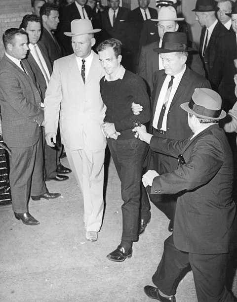 Jack Ruby, just before firing a single shot into Oswald, who is being escorted by police detectives Jim Leavelle (tan suit) and L.C. Graves for the transfer from the city jail to the county jail Lee Harvey Oswald being shot by Jack Ruby as Oswald is being moved by police, 1963.jpg