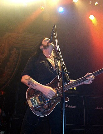 Lemmy - Lemmy playing bass and singing, with his trademark high microphone position
