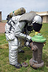 Less water, more pressure yields savings and safer firefighting 130425-F-RC891-100.jpg