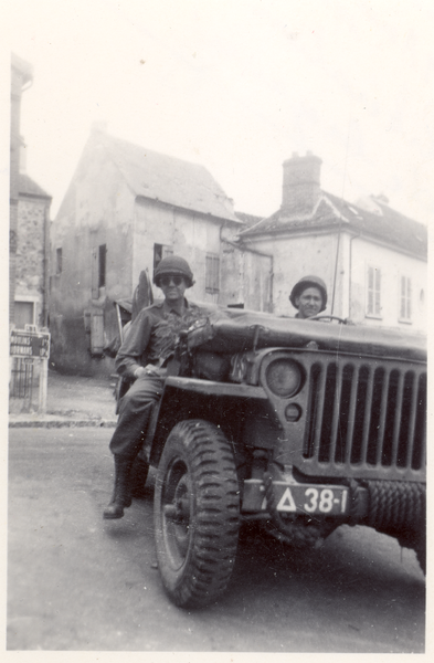 Two GI's and their Jeep on RN 3 in Crézancy, Aisne, France, in 1944.