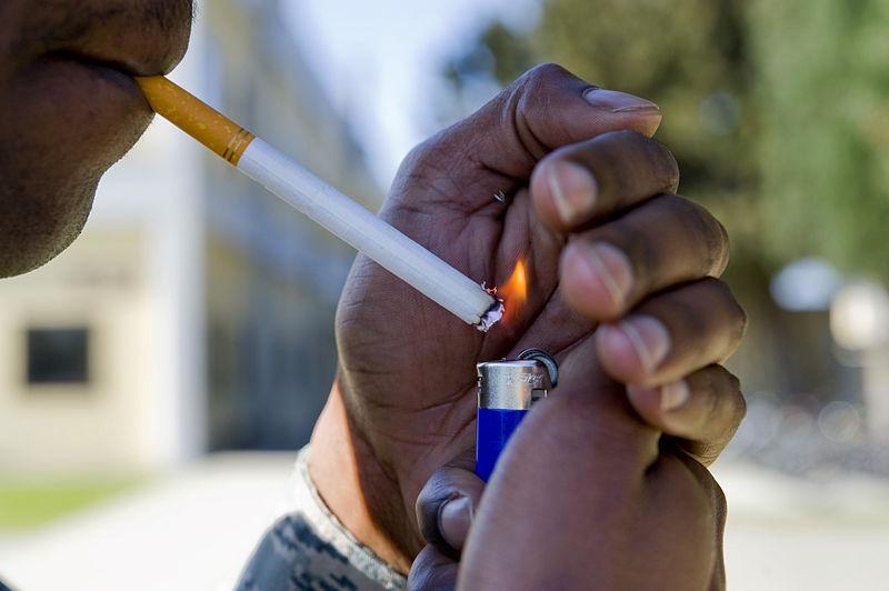 File:Lighting a cigarette.jpg