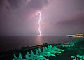 Lightning flashes in view of the aircraft carrier USS Abraham Lincoln (CVN-72).jpg