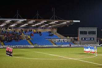 Linfield F.C. - Linfield and Crusaders lining up before the 2013–14 County Antrim Shield final. Linfield would go on to win the Shield 4–1 on penalties. It was David Jeffrey's final trophy as Linfield manager.