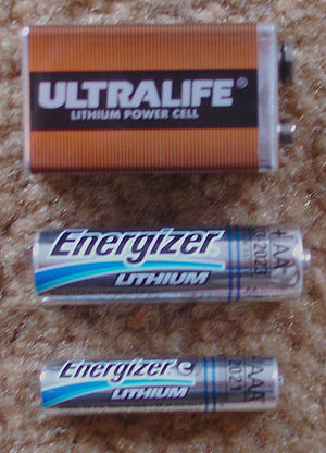 Lithium battery - Lithium 9 volt, AA, and AAA sizes. The top unit has three lithium-manganese dioxide cells internally, the bottom two are lithium-iron disulfide single cells physically and electrically compatible with 1.5 volt zinc batteries.