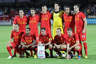 Goalkeeper (association football) - Liverpool F.C. team photo prior to their UEFA Europa League clash against FC Gomel. Note the differing attire of goalkeeper Brad Jones with that of the rest of his teammates.