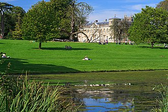 Lydiard Park - Part of lake and park, with house and church tower in the background