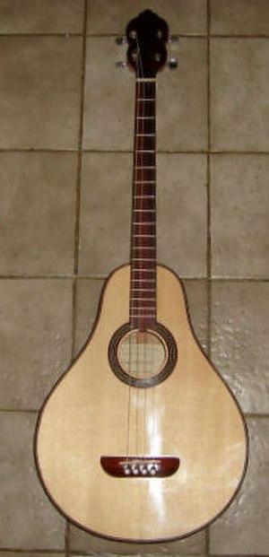 Tenor guitar - Modern replica of a 1930s Lyon & Healy tenor guitar. Background tiles are 20cm square