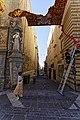 Malta - Valletta - Republic Street - View along Church of Saint Francis of Assisi into Melita Street - Statue of St. Francis.jpg