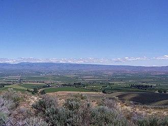 Manastash Ridge - View from Manastash Ridge facing towards Ellensburg, Washington with Cascade Range in the background.