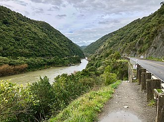 Manawatu Gorge - The sign says the road is closed to all, including pedestrians, under the Government Roading Powers Act 1989. The Manawatu Gorge Track goes under the bridge