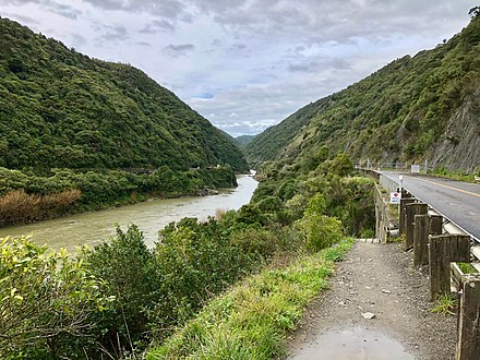 The sign says the road is closed to all, including pedestrians, under the Government Roading Powers Act 1989. The Manawatu Gorge Track goes under the bridge Manawatu Gorge road closure.jpg