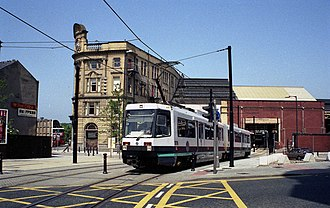 Bury Line - A T-68 tram emerging into the streets from Victoria railway station in June 1992.