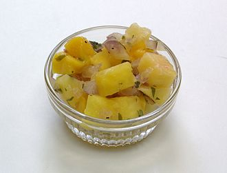 Salsa (sauce) - Mango pineapple salsa, made with jalapeños, red onion, and cilantro (coriander), served in a ramekin