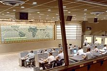 A look inside the Mercury Control Center, Cape Canaveral, Florida. Dominated by the control board showing the position of the spacecraft above ground