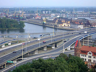 "Transport hub - Szczecin: Port of Szczecin, motorway, expressway and railway connections, an inter-city public transport, a city bus and electric trams network and ""Solidarity"" Szczecin–Goleniów Airport, Poland"